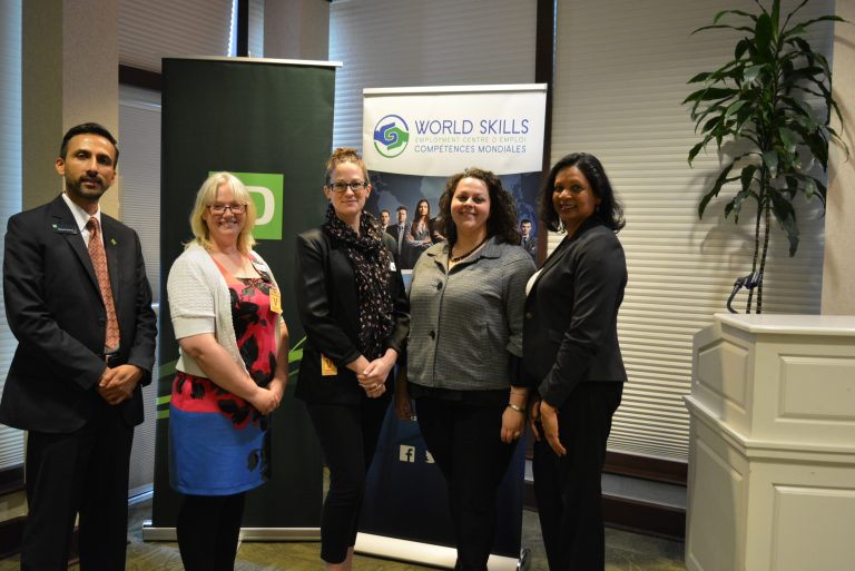 Mayank Sharma, Co-Chair of TD VISMIN; Vikki Broesamble, Kate Oostrom, Shaye Belanger and Magdalene Cooman, staff of World Skills Employment Centre