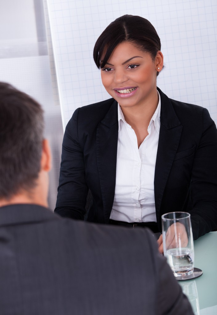 Portrait Of Happy Young Businesswoman Looking At Mature Businessman