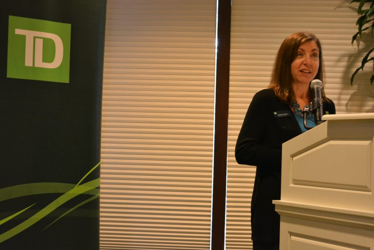 Michelle Wilson, Executive Sponsor, addressing the audience
